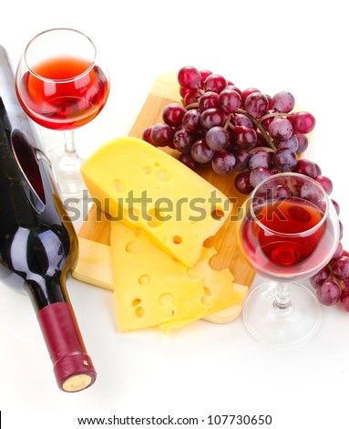 Bottle of great wine with wineglasses and cheese isolated on white - stock photo