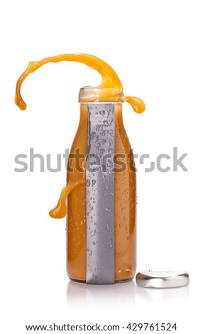 Bottle of juicy orange liquid with blank label and popped cap isolated over white background - stock photo