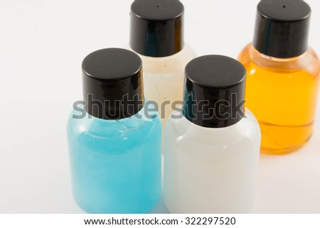 bottle of liquid in white background,it's equipment in bath room are used in hotel