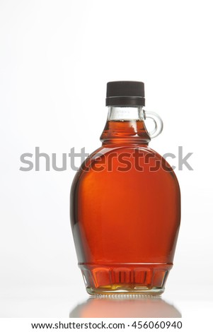 bottle of maple syrup on the white background
