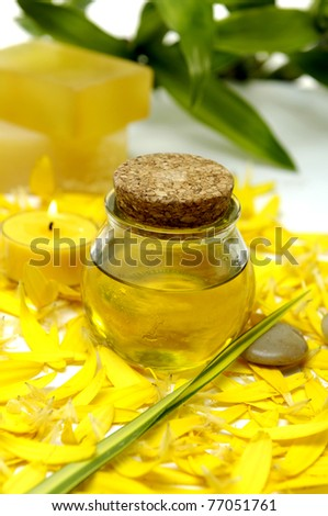 bottle of massage oil and candle with handmade Soap and bamboo - stock photo