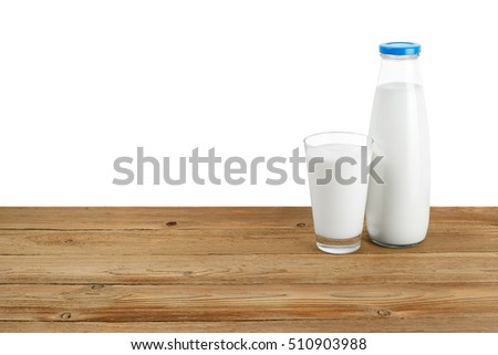 Bottle of milk and glass on wooden table isolated on white background. Dairy product. Milk