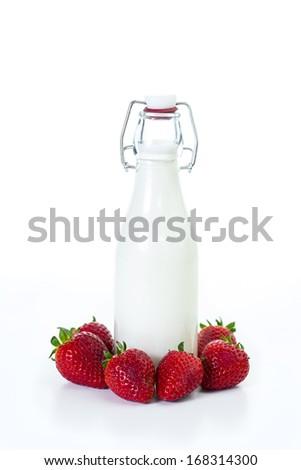 Bottle of milk with fresh strawberry isolated on white background - stock photo