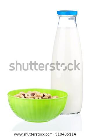 Bottle of milk with tasty cornflakes, isolated on white background  - stock photo