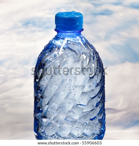 bottle of mineral water on a background of sea waves - stock photo