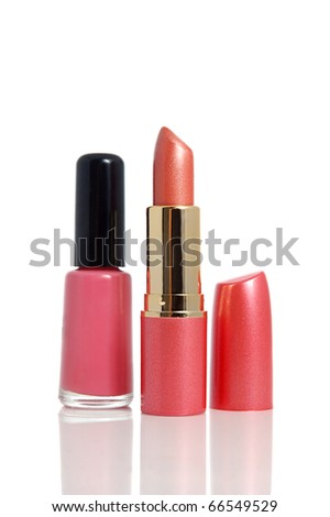 Bottle of nail polish and red lipstick on white background