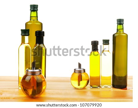 bottle of olive oil on wooden table with white background