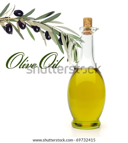 Bottle of olive oil with branch of olive on white