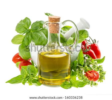 bottle of olive oil with fresh mediterranean herbs and tomatoes isolated on white. food background - stock photo