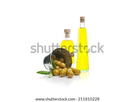 bottle of olive oil with olives isolated dump bucket on white background - stock photo