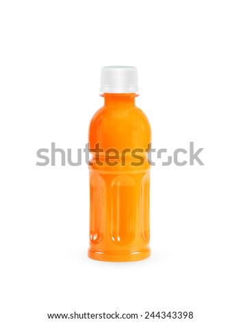 Bottle of orange juice on white background - stock photo