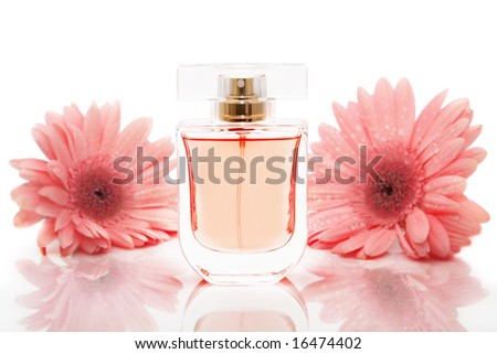 Bottle of perfume and flowers - stock photo