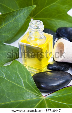 bottle of perfume oil in the environment of the spa - stock photo