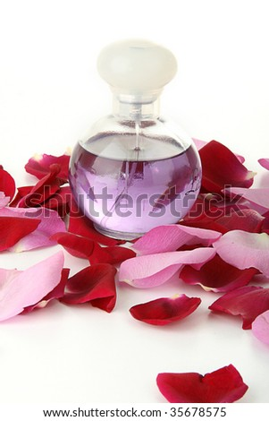 bottle of perfurme with rose petals isolated n white background