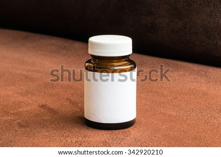 Bottle of pills with white blank label - stock photo