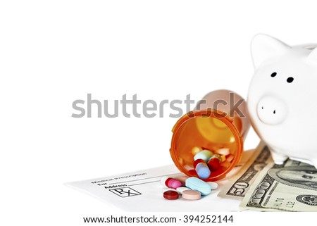 Bottle of prescription medications laying on top of a one hundred dollar bill and a prescription form and piggy bank in background with shallow depth of field isolated on white - stock photo