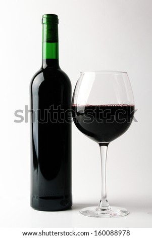Bottle of red wine with glass - stock photo