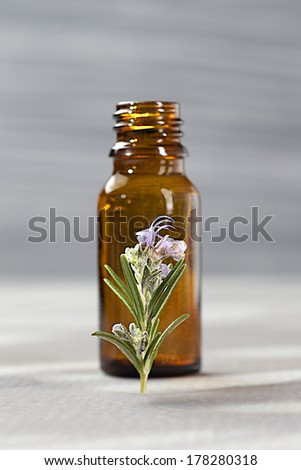 Bottle of rosemary essential oil-Relaxing and beauty treatment - stock photo