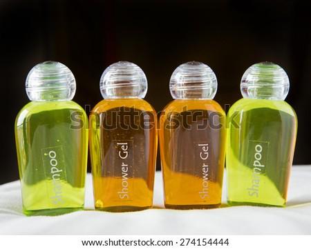 Bottle of shampoo on a towel - stock photo