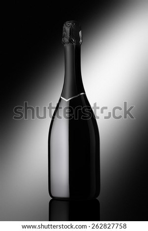 bottle of sparkling wine on a black background - stock photo