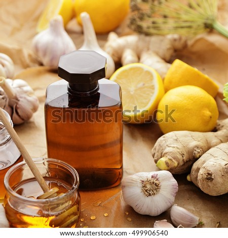 bottle of syrup, honey and herbs