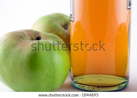 Bottle of traditional cider and apples - stock photo