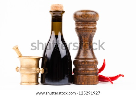 bottle of vinegar with spices isolated on white