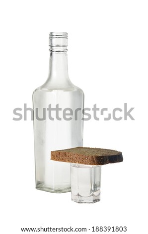 bottle of vodka and a glass with bread