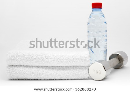 Bottle of water, dumbbell and towel. Isolated on white background - stock photo