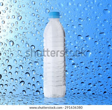 Bottle of water on water drop background - stock photo
