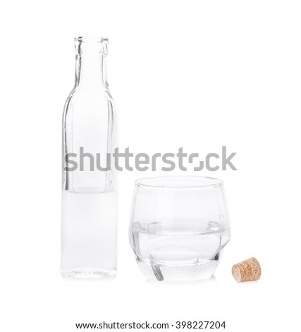 Bottle of water with glass on white background.
