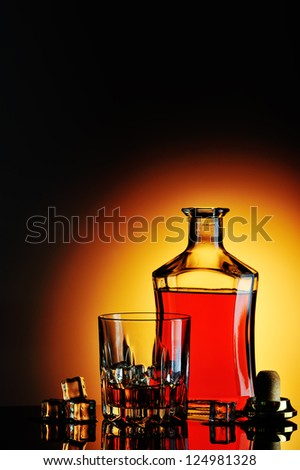 Bottle of whisky and glass - stock photo