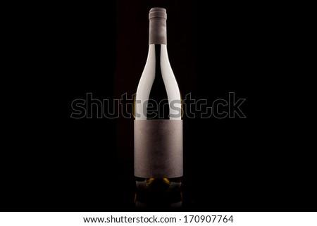 Bottle of white wine on black background - stock photo