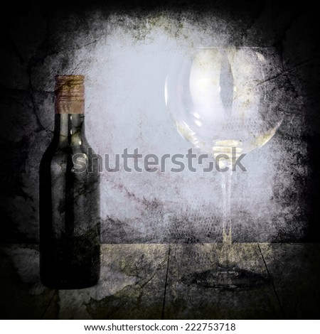 Bottle of wine and big glass on dark background with texture - stock photo