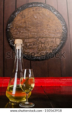 Bottle of wine and glass of wine - stock photo