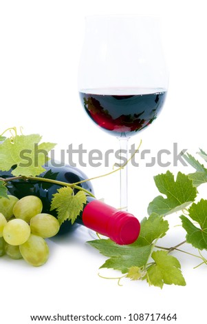 Bottle of wine and grapes. - stock photo