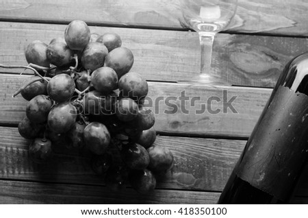 bottle of wine, grapes - stock photo