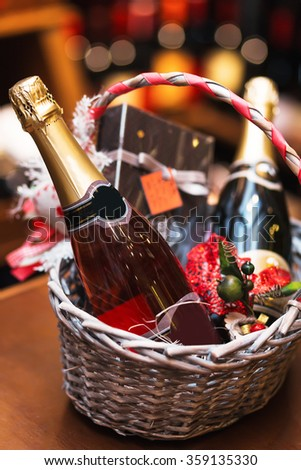 Bottle of wine in basket. Gift for holiday - stock photo