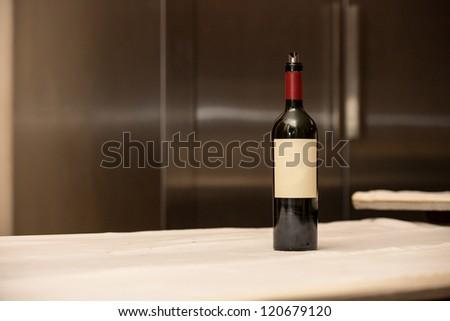 Bottle of wine in kitchen. - stock photo