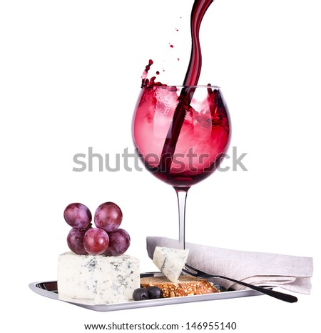 bottle of wine with glass, assortment of  cheese and grapes isolated on white - stock photo