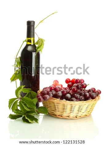 bottle of wine with grapes isolated on white - stock photo