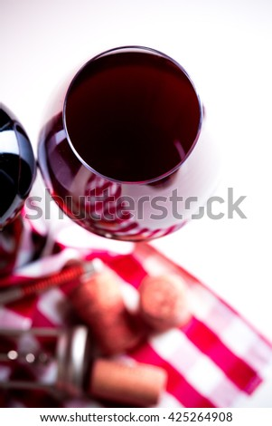 bottle of wine with wine glass on white wooden background - stock photo