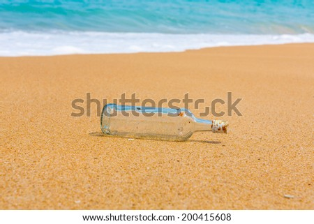 Bottle on a beach - stock photo