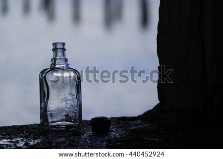 bottle on a blurred background. - stock photo