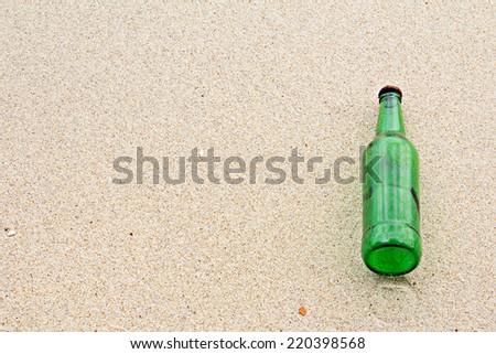 Bottle on beach - stock photo