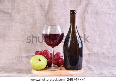 Bottle, red wine in glass with grapes and apple isolated on white background - stock photo