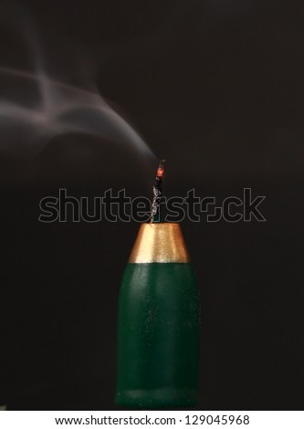 Bottle shaped candle with flame blown out - stock photo