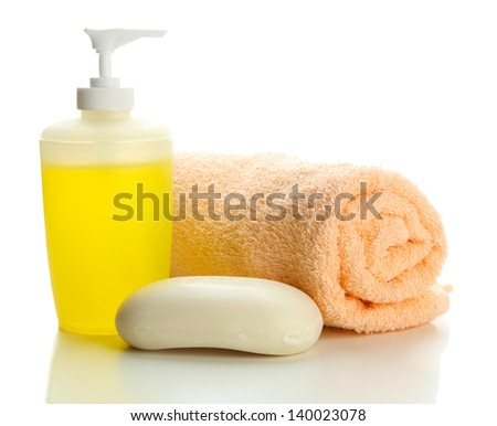 Bottle, soap and towel, isolated on white - stock photo