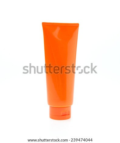 ... young man applying moisturizing cream or lotion on face skin - stock