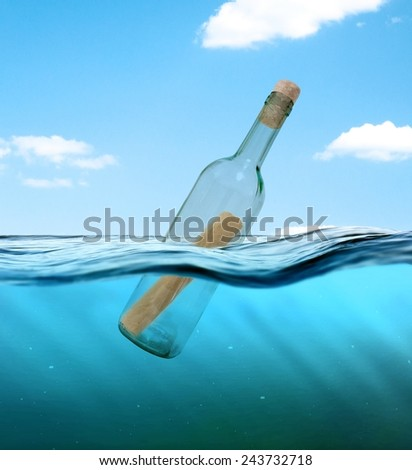Bottle with a letter from the wreck. A bottle with a note floating in the ocean. - stock photo